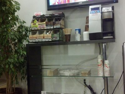 The refreshments area and tv of the waiting room