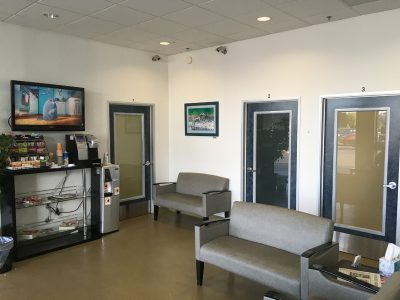 The waiting area of the clinic with a refreshments cart